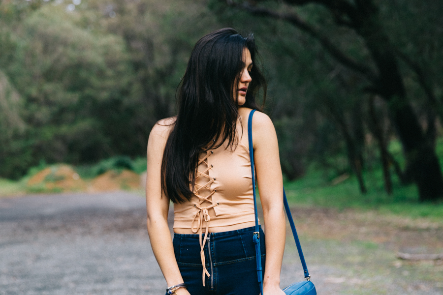 Boho style outfit lace up top.